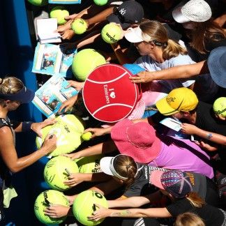 Angie signs autographs for fans after her 1st rd match // Getty Images