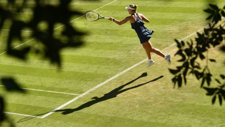 Germany's Angelique Kerber returns to Slovakia's Dominika Cibulkova during their Women's singles second round match at the ATP Nature Valley International tennis tournament in Eastbourne, southern England on June 26, 2018. (Photo by Glyn KIRK / AFP)        (Photo credit should read GLYN KIRK/AFP/Getty Images)