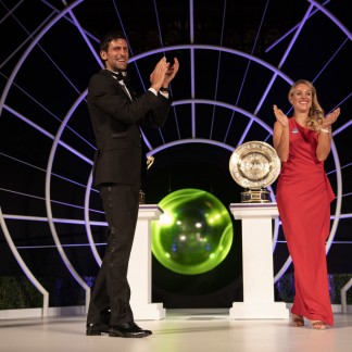 Novak Djokovic and Angelique Kerber share a dance on stage at the Wimbledon Championships Dinner at The Guildhall on July 16, 2018 in London // Getty Images