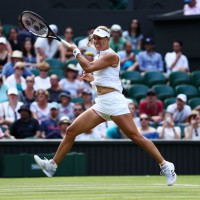 LONDON, ENGLAND - JULY 07:  Angelique Kerber of Germany returns a shot against Naomi Osaka of Japan during their Ladies' Singles third round match on day six of the Wimbledon Lawn Tennis Championships at All England Lawn Tennis and Croquet Club on July 7, 2018 in London, England.  (Photo by Matthew Lewis/Getty Images)