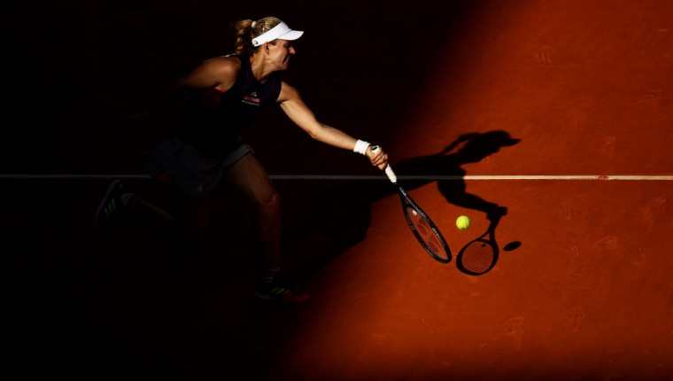 MADRID, SPAIN - MAY 05:  Angelique Kerber of Germany in action against Lesia Tsurenko of Ukraine during day two of the Mutua Madrid Open at La Caja Magica on May 05, 2019 in Madrid, Spain. (Photo by Julian Finney/Getty Images)