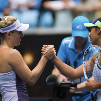 Angelique Kerber of Germany & Priscilla Hon of Australia at the net after their second round match at the 2020 Australian Open Grand Slam tennis tournament